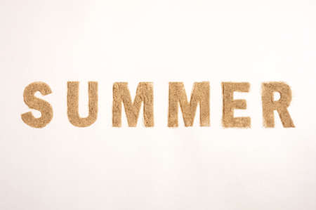 Word Summer Made of Sand isolated on White Background. Top View. Flat Lay. Banque d'images