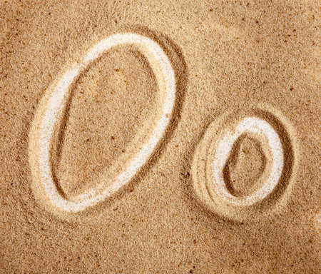 Letter O. English Handwritten Alphabet In The Sand. Banco de Imagens