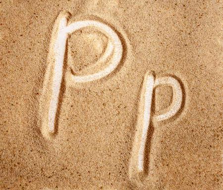Letter P. English Handwritten Alphabet In The Sand.