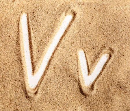 Letter V. English Handwritten Alphabet In The Sand.