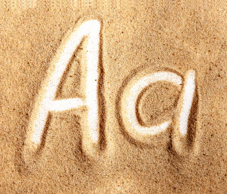 Letter A. English Handwritten Alphabet In The Sand.