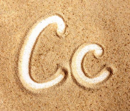 Letter C. English Handwritten Alphabet In The Sand.