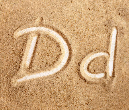 Letter D. English Handwritten Alphabet In The Sand. Banque d'images