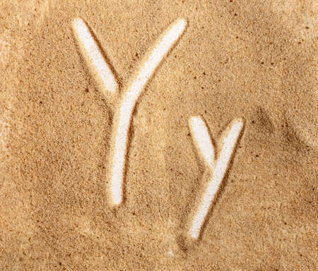 Letter Y. English Handwritten Alphabet In The Sand. Banque d'images