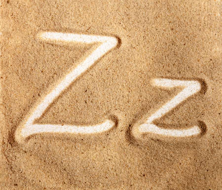 Letter Z. English Handwritten Alphabet In The Sand. Banque d'images