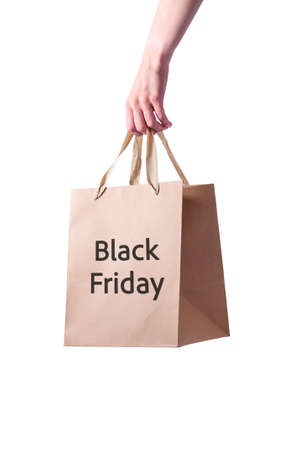 Black Friday. Paper Bag in Woman Hand. Concept Sale