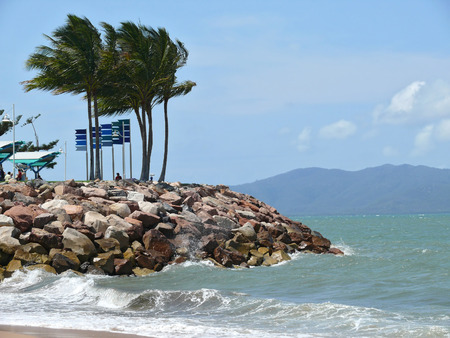 Australia. Queensland. Great Barrier Reef. The beach of Townswille in afternoon with strong wind. photo