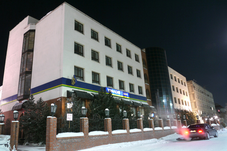 Nadym, Russia - February 25, 2013: The Bank building, close-up, parked next car. Far north, Nadym. Stock Photo - 27131060