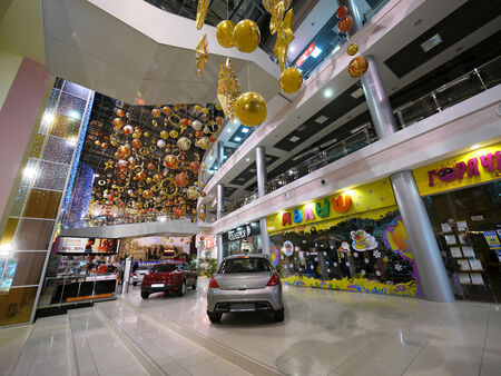 MOSCOW, RUSSIA - NOVEMBER 29, 2010: Mall with cars. New Year in Moscow, Russia - November 29, 2010. Christmas decorations.