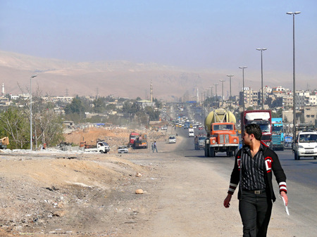 damascus: SYRIA, Damascus - November 5: Unknown man close up in Syria, Damascus - November 5, 2008. View of the city, the road.