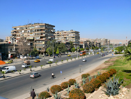 Syria, Damascus - November 5, 2008: Strangers. City, buildings, roads with cars.