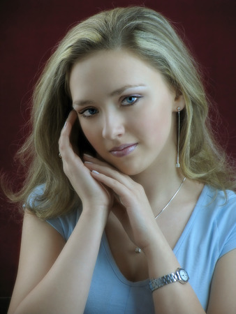 gentile: Portrait of the beautiful white girl with gentile  glance in studio.