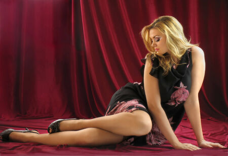 Graceful beautiful blonde in a dress. Studio photography. photo