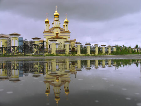 reflectivity: The Christian Church and its reflection in the water. Stock Photo