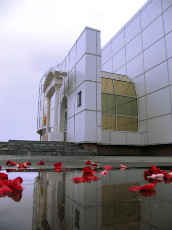 reflectivity: Nadym, Russia - June 18, 2005: City registry office in Nadym, Russia - June 18, 2005. Rose petals scattered around the building.