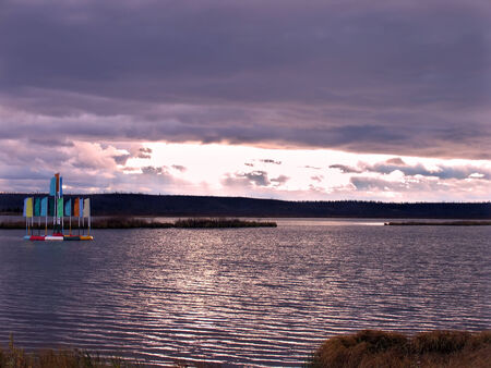 gleams: Landscape nature. The river on a background of a cloudy sky with gleams of sun. Stock Photo