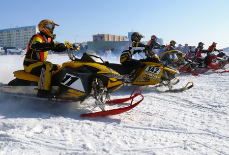 double cross: Nadim, Russia - April 12, 2008  Unknown athletes at the start, the beginning of the competition  Athletes snowmobile race on speed  Snow cross-country race  Jump  Editorial