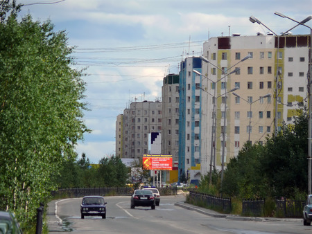 Nadym, Russia - July 21, 2007: the City skyline in Nadym, Russia - July 21, 2007. City Central road with riding on her car.