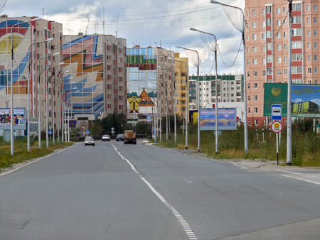 Nadym, Russia - August 21, 2007: the City skyline in Nadym, Russia - August 21, 2007. City Central road with riding on her car.