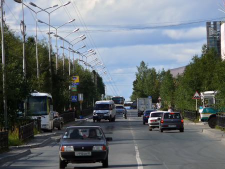 Nadym, Russia - August 21, 2007: the City skyline in Nadym, Russia - August 21, 2007. City Central road with riding on her car. Editorial