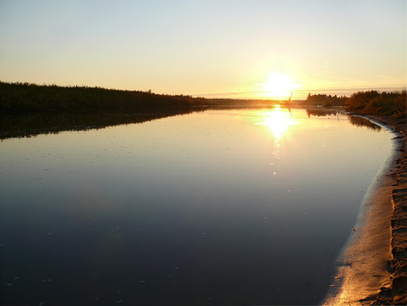northern nature: The landscape of the Northern nature. The sun above the river Nadym.