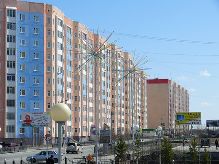 Nadym, Russia - May 17, 2008: the City skyline in Nadym, Russia - May 17, 2008. City Central road with riding on her car.