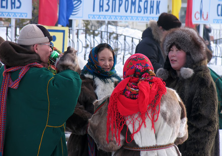herder: Nadym, Russia -  March 17, 2006: the national holiday, the day of the reindeer herder in Nadym, Russia -  March 17, 2006. Strangers - Nenets communicate with each other.
