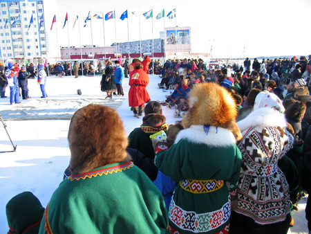 herder: Nadym, Russia - March 2, 2007: the national holiday, the day of the reindeer herder in Nadym, Russia - March 2, 2007. The view on the square, the crowd of spectators.