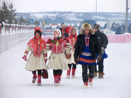 herder: Nadym, Russia - March 3, 2007: the national holiday, the day of the reindeer herder in Nadym, Russia - March 3, 2007. Unknown group of people walking along the road.