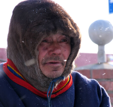 herder: Nadym, Russia - March 11, 2005: the national holiday, the day of the reindeer herder in Nadym, Russia - March 11, 2005. Unknown man Nenets close-up, portrait. Editorial