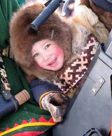herder: Nadym, Russia - March 11, 2005: the national holiday, the day of the reindeer herder in Nadym, Russia - March 11, 2005. Unknown boy Nenets on the snowmobile. Editorial