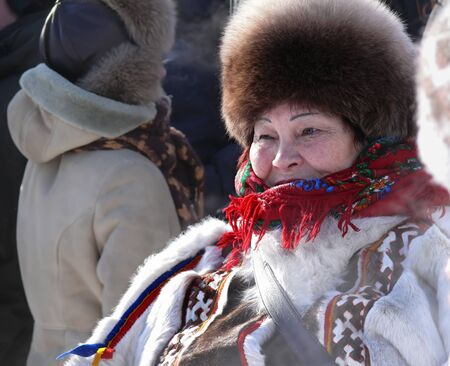 herder: Nadym, Russia - March 15, 2008: the national holiday, the day of the reindeer herder in Nadym, Russia - March 15, 2008. Unknown woman - Nenets woman, closeup, on the street.