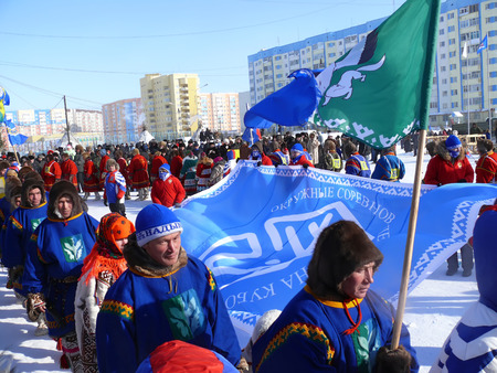 herder: Nadym, Russia - March 15, 2008: the national holiday - the Day of the reindeer herder in Nadym, Russia - March 15, 2008. Strangers, the teams are standing on the square with flags and plates.