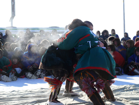 scolded: NADYM, RUSSIA - March 15, 2008: National Holiday - Day of the reindeer herders. The wrestling unknown men on holiday in Nadym, Russia - March 15, 2008. Editorial