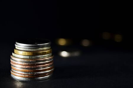 coins iron stack close-up on a black background horizontal orientation
