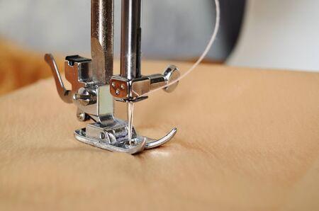 sewing machine close-up of needle in fabric Archivio Fotografico