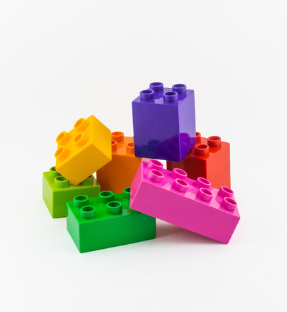 yellow lego block: Colorful Building plastic toy Blocks Isolated On White Stock Photo