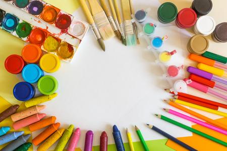 gouache: Colored paper, felt-tip pens, pencils, watercolors, brushes and gouache frame Stock Photo