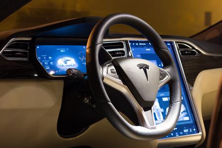 LJUBLJANA, SLOVENIA - October 13, 2016: Steering wheel and dashboard of Tesla Model S car at night