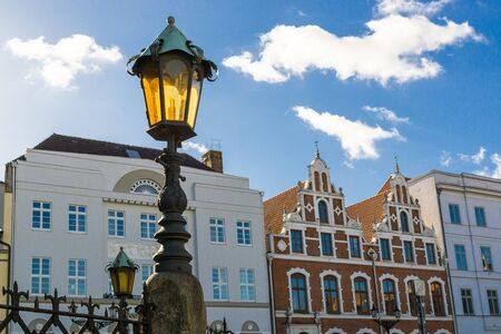 residential idyll: View of Wismar Old Town streets with vintage houses and lantern, Germany