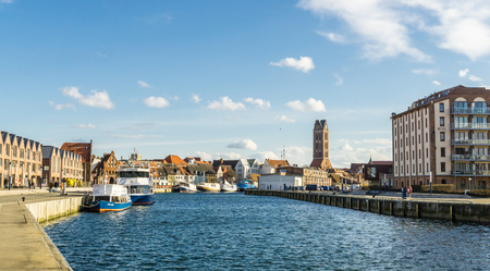 View of Wismar Old harbor with ships and houses Editorial