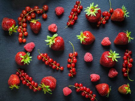 Berries flat lay with redcurrant, strawberry and raspberry