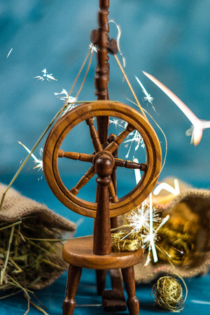 Magic spinning wheel spin straw to gold whith sparkles from grimm's fairy tale Rumpelstiltskin