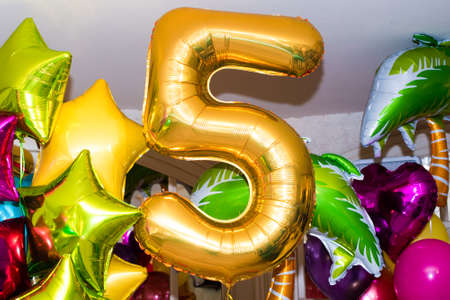 festive composition of balloons. golden number 5. multicolored stars, hearts, round balls. Stockfoto