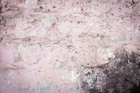 old brick wall. cracked concrete, mold. pink, brown texture. vintage background rustic style