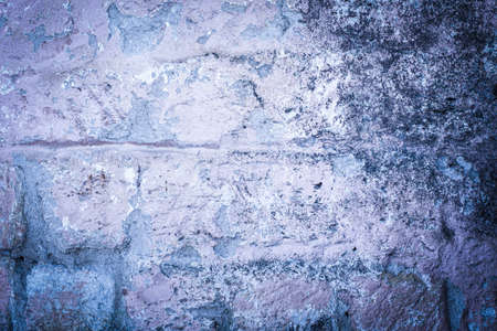 old brick wall. cracked concrete, mold. purple, blue texture. vintage background rustic style