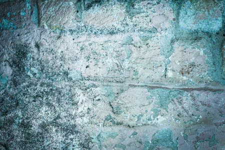 old brick wall. cracked concrete, mold. Green tide, blue texture. vintage background rustic style Stockfoto