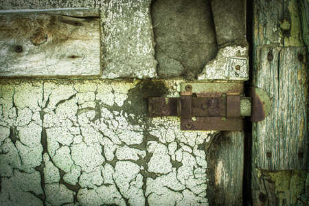 rusty lock on a texture of old, wooden, Green tide, celadon door, which the old paint flaking. the passage is closed. locked. place for text Stockfoto