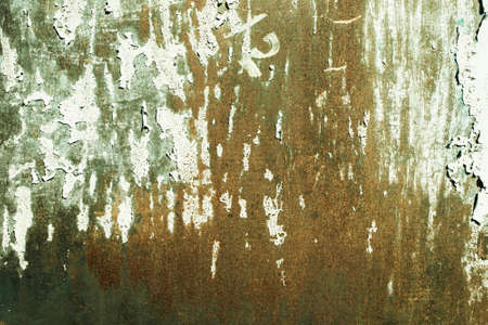 Green, celadon, orange, rusty texture. old rusty wall backgrounds. roughness and cracks. Stockfoto