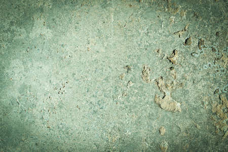 celadon green concrete old wall. cement texture. scuffs and cracks. frame